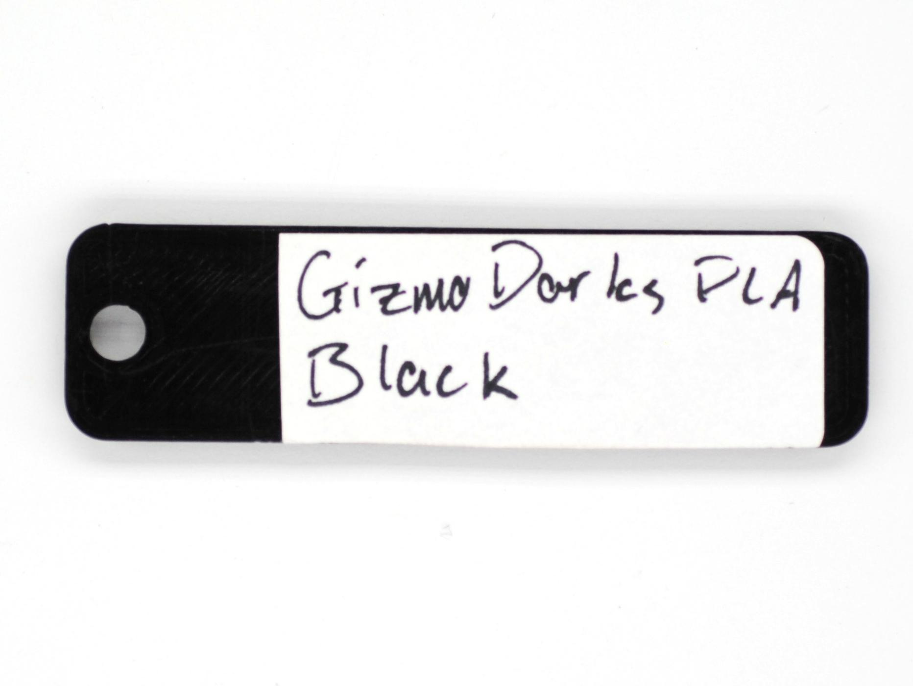 An image of the back of a color swatch, with the manufacturer, type, and color written on it.